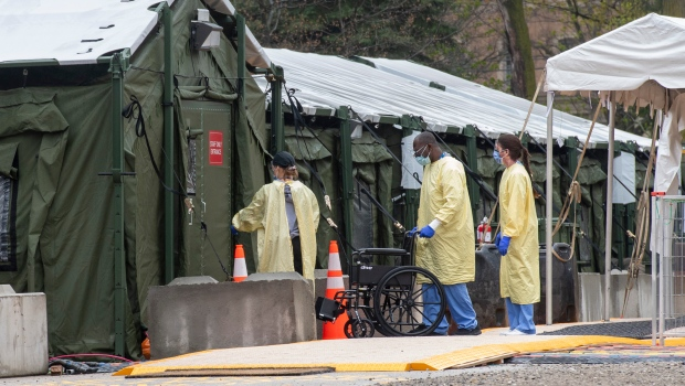 Staff enter the mobile field hospital in the parking lot at Sunnybrook Hospital in Toronto on Tuesday May 4, 2021. THE CANADIAN PRESS/Frank Gunn