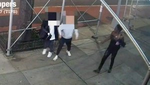 Two Asian women, ages 29 and 31, were attacked by a woman with a hammer on a Manhattan street.