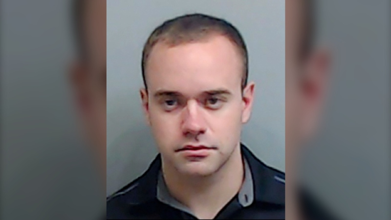 In this booking file photo made available Thursday, June 18, 2020, by the Fulton County, Ga., Sheriff's Office, is Atlanta Police Officer Garrett Rolfe. The former Atlanta police officer's attorney said Thursday, April 22, 2021, that his client didn't get a chance to defend himself before he was fired for fatally shooting Rayshard Brooks, a Black man who had been running away from two white officers after he resisted arrest and fired a stun gun at one of them. (Fulton County Sheriff's Office via AP, File)