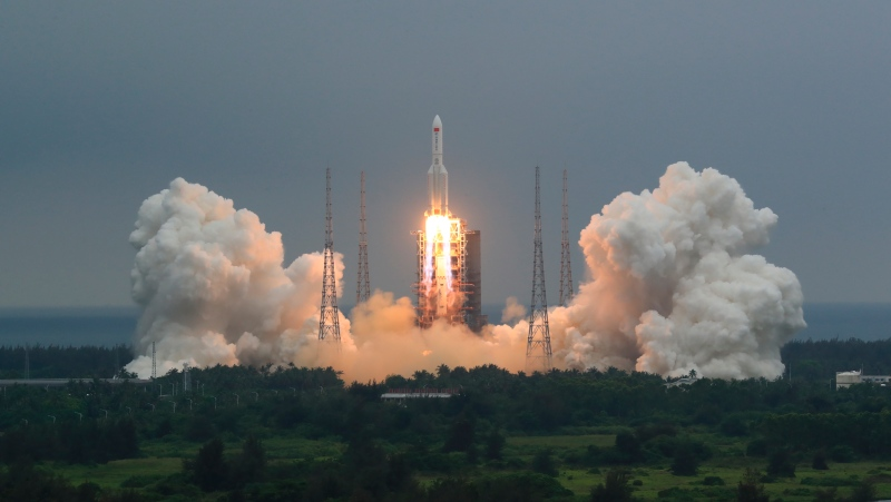 In this April 29, 2021, file photo released by China's Xinhua News Agency, a Long March 5B rocket carrying a module for a Chinese space station lifts off from the Wenchang Spacecraft Launch Site in Wenchang in southern China's Hainan Province. The central rocket segment that launched the 22.5-ton core of China's newest space station into orbit is due to plunge back to Earth as early as Saturday in an unknown location. (Ju Zhenhua/Xinhua via AP, File)