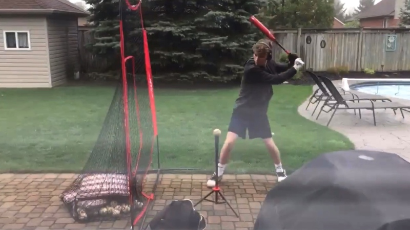 Evan Burns practicing baseball in his yard on May 5, 2021. (Brent Lale/CTV London)