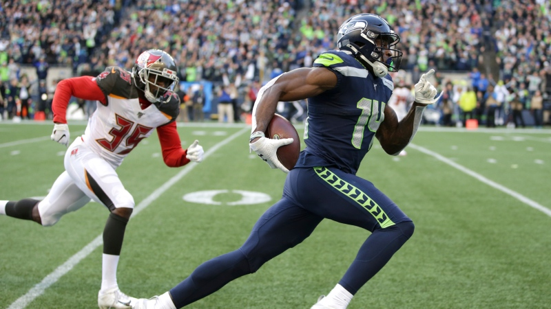 Seattle Seahawks wide receiver DK Metcalf, right, runs to score a touchdown ahead of Tampa Bay Buccaneers defensive back Jamel Dean during the second half of an NFL football game in Seattle, in this Sunday, Nov. 3, 2019, file photo. (AP Photo/Scott Eklund, File)