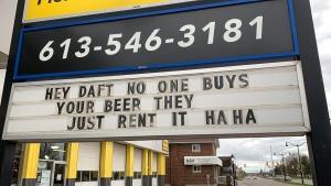 Ok Auto in Kingston participates in the Sign War. (Kimberley Johnson/CTV News Ottawa)