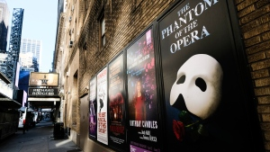 Broadway posters hang outside the Richard Rodgers Theatre during Covid-19 lockdown in New York on May 13, 2020. (Photo by Evan Agostini/Invision/AP)
