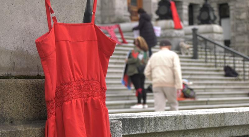 A red dress hangs at the B.C. legislature May 5, 2021. (CTV)