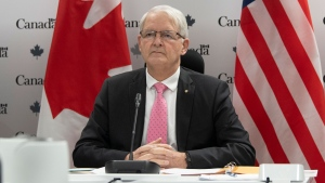 Foreign Affairs Minister Marc Garneau waits for a virtual meeting to begin with US Secretary of State Antony Blinken in Ottawa, Friday February 26, 2021. THE CANADIAN PRESS/Adrian Wyld