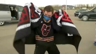 A group of Calgary Hitmen superfans got a special treat from the team Wednesday
