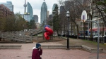 A woman walks through a empty play area in Toronto on Saturday April 17, 2021. (THE CANADIAN PRESS/Chris Young)