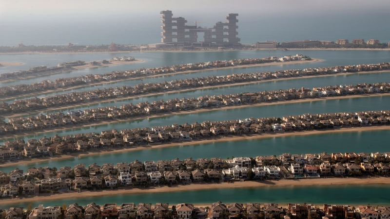 Villas one the fronds of the Jumeirah Palm Island are seen from the observation deck of The View at The Palm Jumeirah, in Dubai, United Arab Emirates, Tuesday, April 6, 2021. Foreign buyers flush with cash have flooded the high-end property market in Dubai.  (AP Photo/Kamran Jebreili)