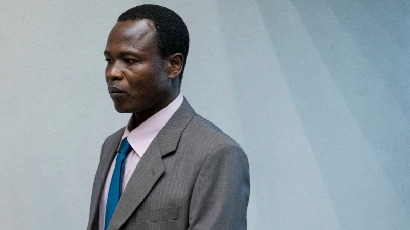 FILE- In this Tuesday, Dec. 6, 2016, file photo, Dominic Ongwen, a senior commander in the brutal Ugandan rebel group Lord's Resistance Army, whose fugitive leader Kony is one of the world's most-wanted war crimes suspects, enters the court room of the International Court in The Hague, Netherlands.(AP Photo/Peter Dejong, File)