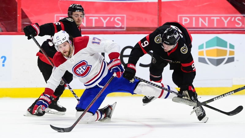 Montreal Canadiens' Josh Anderson (17) falls to the ice as Ottawa Senators' Josh Norris (9) defends during first period NHL action in Ottawa on Wednesday, March 5, 2021. THE CANADIAN PRESS/Sean Kilpatrick