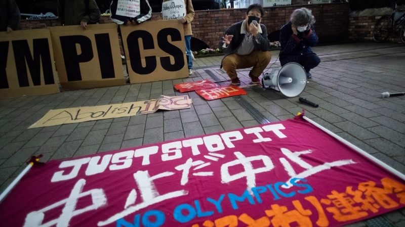 "In this March 25, 2021, file photo, a ""No Olympics"" banner is placed by protesters in Tokyo during a demonstration against the going ahead of the Tokyo 2020 Olympic and Paralympic Games. An online petition calling for the Tokyo Olympics to be canceled has gained ten of thousands of signatures since being launched in Japan just a few days ago. The rollout comes with Tokyo, Osaka and several other areas under a state of emergency with coronavirus infections rising — particularly new variants. (AP Photo/Hiro Komae, File)"