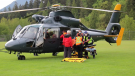 Members of North Shore Rescue transfer a mountain biker from Mount Seymour on Wednesday, May 5, 2021.