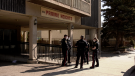 Police are seen at the Prairie Heights condo building on May 6, 2021. (Chad Hills/CTV Saskatoon)