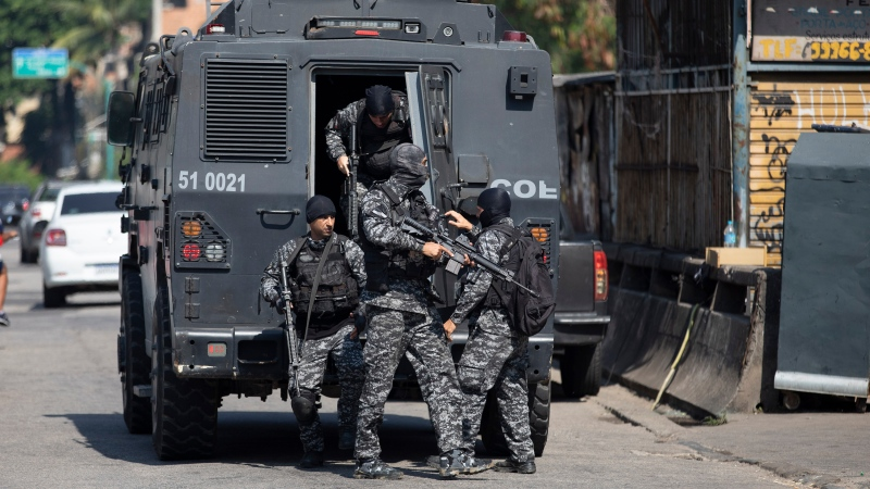 Police get out of an armored vehicle during an operation against alleged drug traffickers in the Jacarezinho favela of Rio de Janeiro, Brazil, Thursday, May 6, 2021. (AP Photo/Silvia Izquierdo)