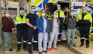 Pictured are one of the teams involved in the land transfer of patients. Health Sciences North has now taken in six COVID-19 patients from southern Ontario, and expects to receive more. (Supplied)