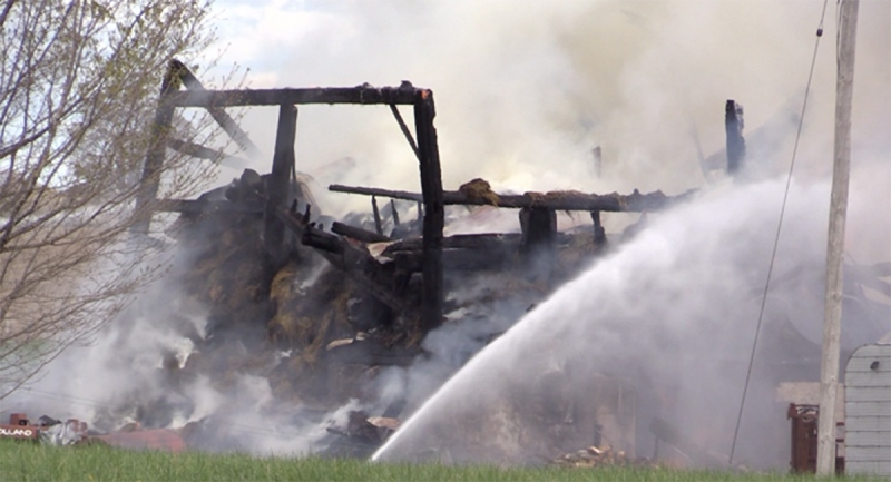 Fire has destroyed a barn south of Wingham, Ont. on Thursday, May 6, 2021. (Scott Miller / CTV News)