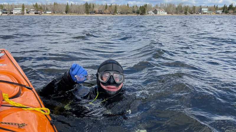 Terry Korz, a master diver at Edmonton's The Dive Outfitters, decided to try to find his $1,200 pair of glasses he lost while ice fishing at Lac Ste. Anne. He and a group set out on May 2, 2021. (Courtesy: Stuart Serediuk)