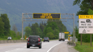 A sign on a B.C. highway asks would-be travellers to stay home on May 6, 2021. (Jordan Jiang / CTV News Vancouver)