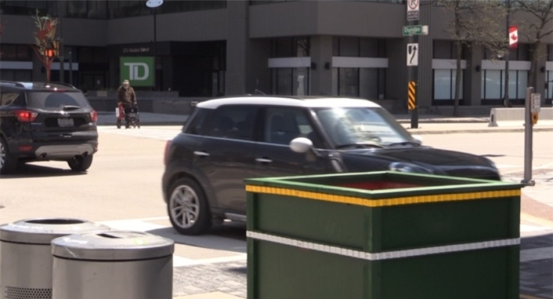 A driver goes around new barricades on Dundas Place in London, Ont. on Thursday, May 6, 2021. (Daryl Newcombe / CTV News)