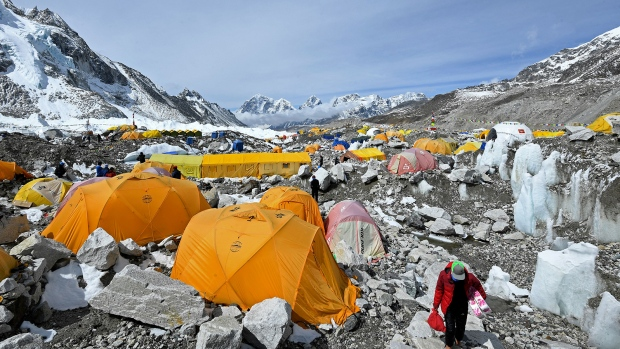Climbers rejoiced when Nepal decided to reopen its side of Mount Everest this year, but reports suggest even the world's highest peak isn't safe from the spread of coronavirus. (Prakash Mathema/AFP/Getty Images)