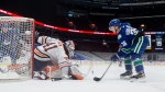 Edmonton Oilers goalie Mike Smith (41) stops Vancouver Canucks' Nils Hoglander (36), of Sweden, during the first period of an NHL hockey game in Vancouver, on Tuesday, May 4, 2021 (The Canadian Press/Darryl Dyck).