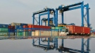 A truck transports containers at a container port on the Yangtze River in Nantong in eastern China's Jiangsu province on April 8, 2021. (Chinatopix via AP)