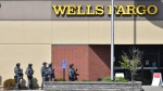 SWAT team officers respond to the scene of a reported hostage situation at the Wells Fargo branch Thursday May 6, 2021, in south St. Cloud, Minn. (Dave Schwarz/St. Cloud Times via AP)