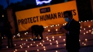 Amnesty International holds a vigil for Human Rights in India ahead of the EU-India Summit in Porto, Portugal, Thursday, May 6, 2021. (AP Photo/Francisco Seco)