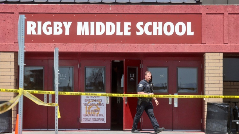 A police officer walks out of Rigby Middle School in Rigby, Idaho, following a shooting on May 6, 2021. (Natalie Behring / AP)