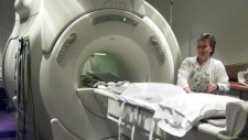 Technician Ina Matson prepares an MRI machine for use at a private clinic in Calgary, Thursday November 28, 2002. (CP PHOTO/Adrian Wyld)