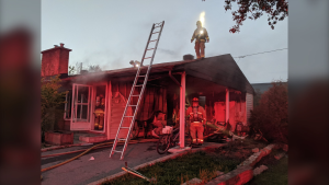 Ottawa firefighters responded to a fire in a home on Avenue U Thursday night, one of three fires in a span of three hours. (Photo courtesy: Twitter/OFSFirePhoto)