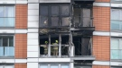 Firefighters inspect damage to a 19-storey tower block in New Providence Wharf in London, on May 7, 2021. (Yui Mok/PA via AP)