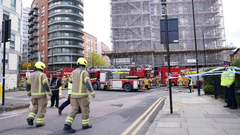 Firefighters at the scene in New Providence Wharf in London, on May 7, 2021. (Yui Mok/PA via AP)