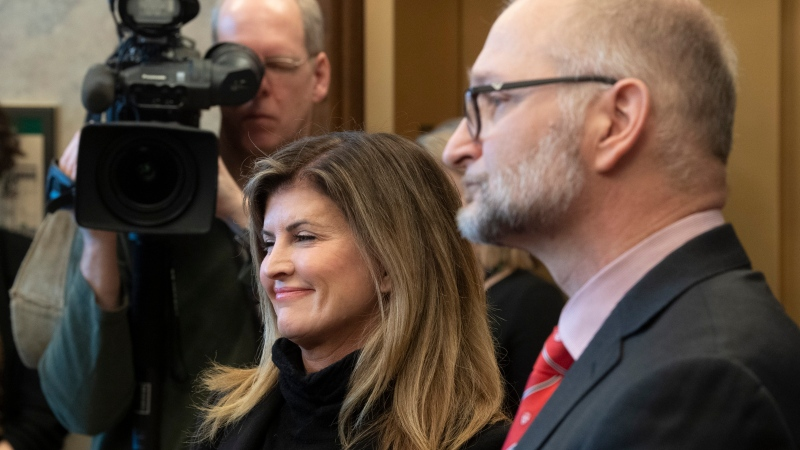 Rona Ambrose smiles as she listens to a speaker with Minister of Justice and Attorney General of Canada David Lametti during an announcement, Tuesday February 4, 2020 on Parliament Hill in Ottawa. THE CANADIAN PRESS/Adrian Wyld