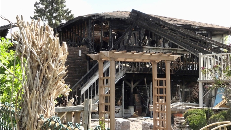 A home on Southfield Drive in Strathroy is seen destroyed on Friday, May 7, 2021 following a fire the night before. (Jim Knight / CTV London)