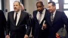 Harvey Weinstein, left, enters court in New York with attorneys Ron Sullivan, centre, and Jose Baez, on Jan. 25, 2019. (Mark Lennihan / AP)