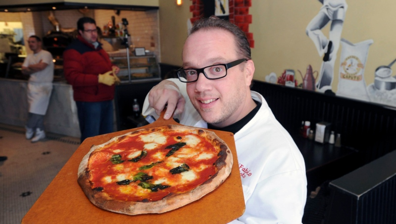 "In this Jan. 29, 2014 file photo, Bruno DiFabio displays a Margherita pizza at ReNapoli Pizzeria & Chicago Italian Beef in Old Greenwich, Conn. Celebrity pizza chef Bruno DiFabio has been sentenced to 30 days in prison for tax evasion. Known as ""Lord of the Pies,"" DiFabio was sentenced Thursday, May 6, 2021 in federal court in Bridgeport, Connecticut. (Bob Luckey/Hearst Connecticut Media via AP, File)"