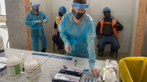 Nurses administer rapid COVID-19 tests at a construction site n Toronto on Thursday, February 18, 2021. THE CANADIAN PRESS/Frank Gunn