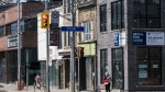 Advertisements for retail spaces available for lease are displayed along Queen Street West in Toronto on Tuesday, March 9, 2021. THE CANADIAN PRESS/Tijana Martin