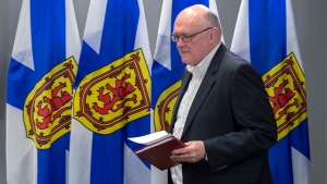 Dr. Robert Strang, chief medical officer of health, arrives to announce two more presumptive cases of COVID-19 in Nova Scotia at a briefing in Halifax on Tuesday, March 17, 2020.THE CANADIAN PRESS/Andrew Vaughan