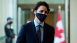 Prime Minister Justin Trudeau makes his way to hold a press conference to update Canadians on the COVID-19 pandemic, in Ottawa on Friday, May 7, 2021. THE CANADIAN PRESS/Sean Kilpatrick