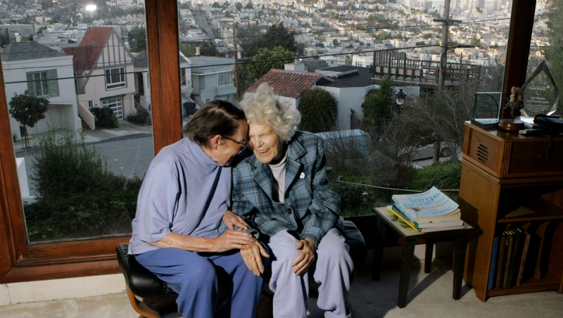 In this March 3, 2008, file photo, Phyllis Lyon, left, and Del Martin are photographed at home in San Francisco. The hilltop cottage of the couple that became the first same-sex partners to legally marry in San Francisco has become a city landmark. The San Francisco Board of Supervisors voted unanimously Tuesday, May 4, 2021, to give the 651 Duncan St. home of the lesbian activists landmark status. The home in the Noe Valley neighborhood is expected to become the first lesbian landmark in the western United States, the San Francisco Chronicle reported. (AP Photo/Marcio Jose Sanchez, file)