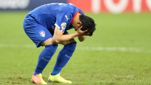 Suwon Samsung Bluewings' Jang Ho-Ik reacts after missed a penalty shot during a penalty kick shoot-out during the Champions League, quarter final, soccer match between Vissel Kobe and Suwon Samsung Bluewings in Doha, Qatar on Dec. 10, 2020. (AP Photo/Hussein Sayed)