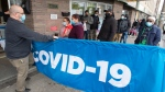 People line up for their shots at a walk-in mobile COVID-19 vaccination clinic at the Masjid Assuna mosque Wednesday, May 5, 2021 in Montreal. THE CANADIAN PRESS/Ryan Remiorz