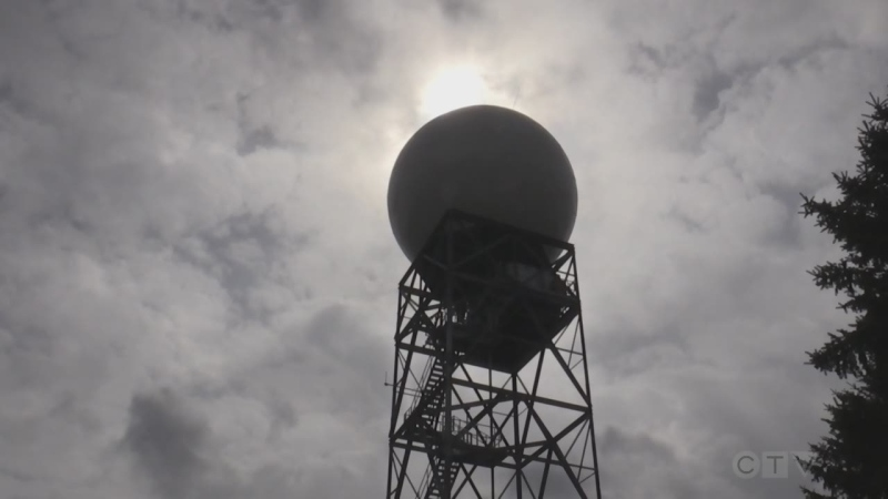 Environment Canada engineers construct a new fiberglass dome weather radar tower in King City, Ont. Fri. May 7, 2021 (Roger Klein/CTV News)