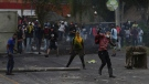 Anti-government protesters clash with police in Gachancipa, Colombia, Friday, May 7, 2021. (AP Photo/Ivan Valencia)