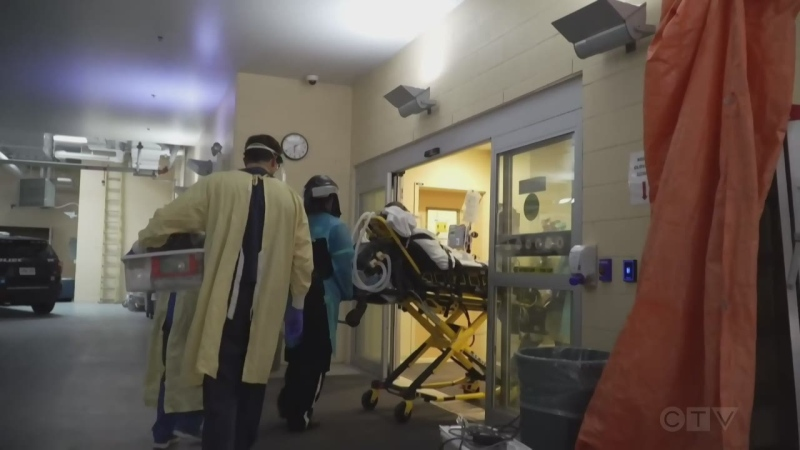 Health care workers bring a patient into the hospital. (Supplied)