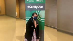 In this family photo, Maya Dressler, 15, poses after getting her first COVID-19 vaccination in London, Ont. on Wednesday, May 5, 2021.