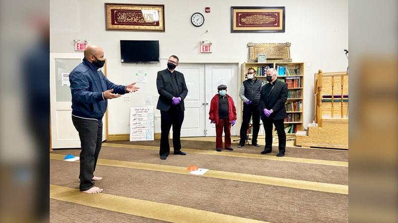 Members of the Ascension Catholic Parish donated the packages to the NW Islamic Centre in front of a small gathering of members from both communities.